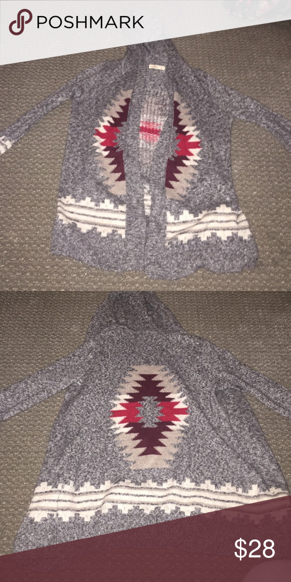 Hollister hooded cardigan Hollister dark grey and patterned hooded cardigan, worn a few times. super cute, and seriously goes with anything Hollister Sweaters Cardigans