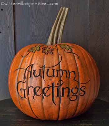 "Autumn Greetings Pumpkin  From the Salem Collection, this orange resin pumpkin stands approx. 10 1/4 inches tall, 7 1/2 inches wide, and has been ""carved"" with a leaf design and the words Autumn Greetings.    PROUDLY MADE IN THE USA!  Price:	$ 39.95"