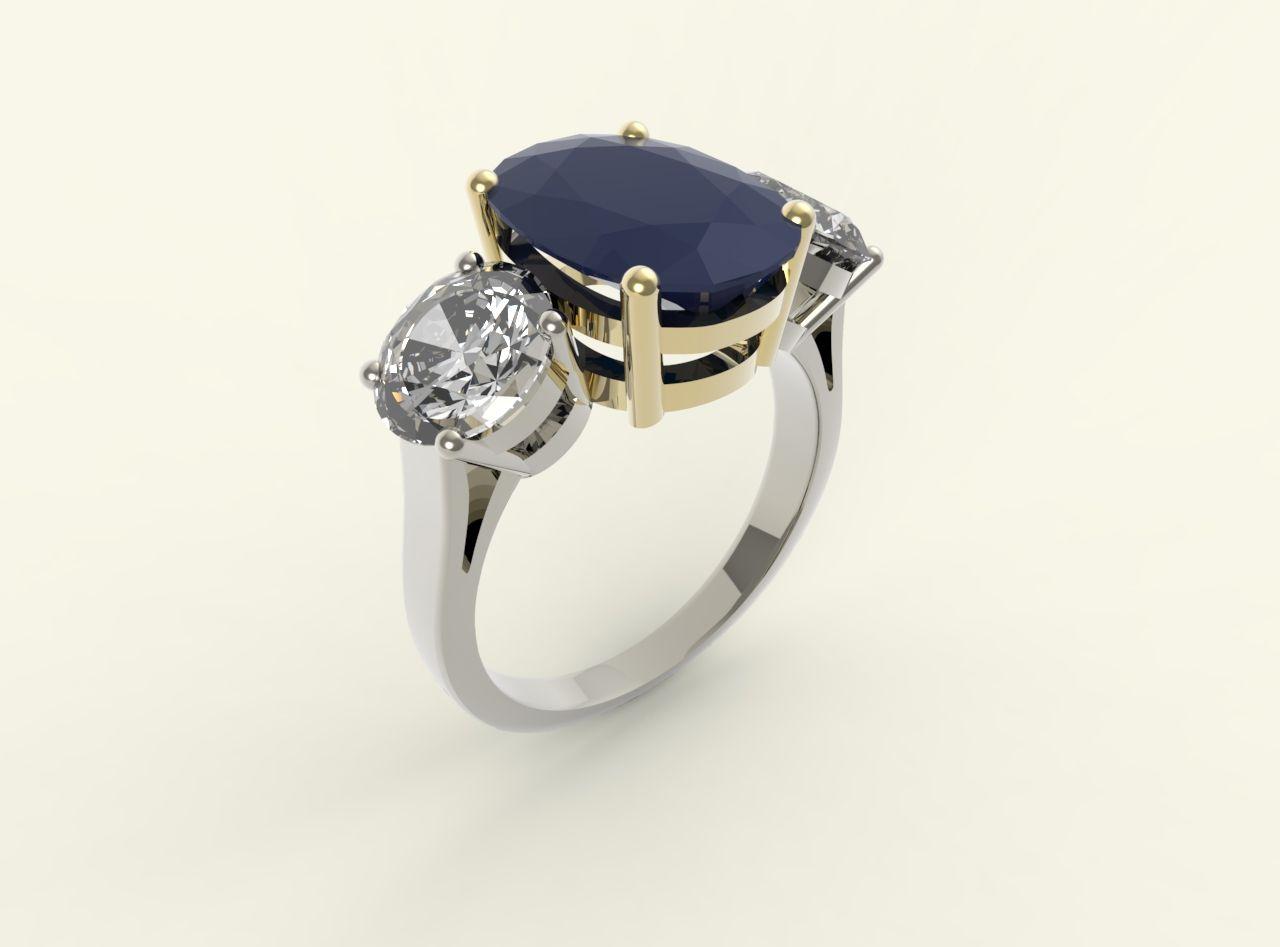 Sortija de Zafiro y dos diamantes talla Bte. en O.B, y O. A.