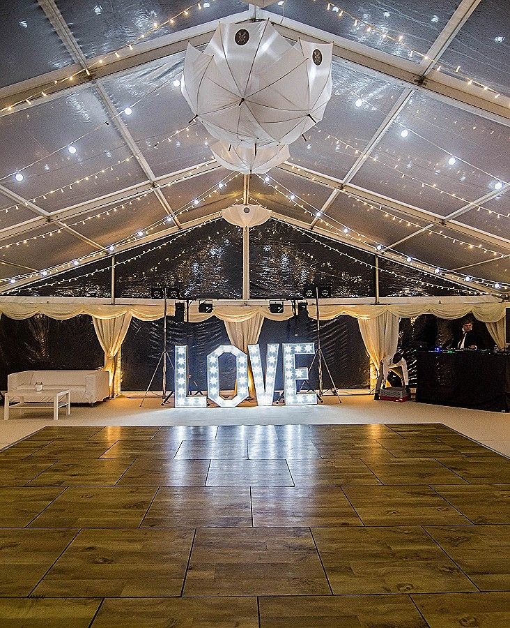 Clear Roofs Are Used Over The Dance Floor Area Decorated