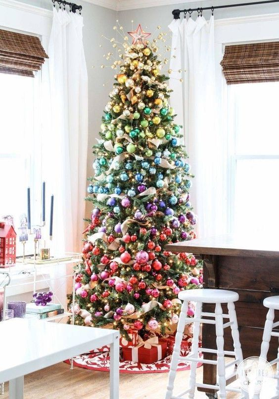 a faux Christmas tree decorated with ornaments of all shades