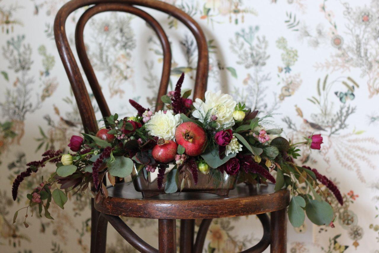 horizontal arrangement with dahlias and pomegranates
