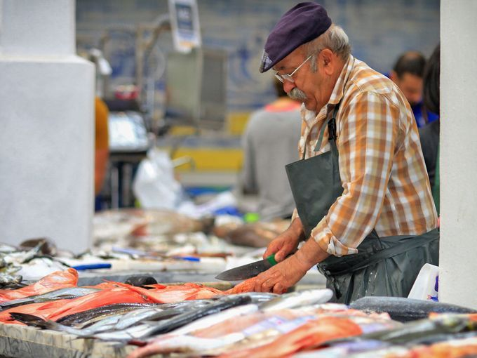 """Mercado Livramento in Setúbal is one of the """"Famous fish markets around the world"""" according to USA Today 15.06.2015   A fishmonger at the market prepares an array of freshly caught fish daily."""
