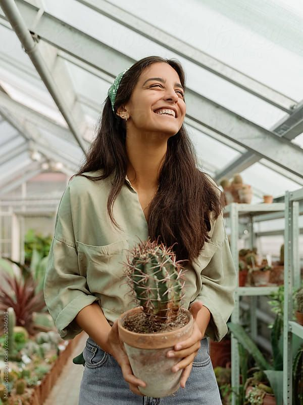 Photo of Laughing girl working with cactuses by Milles Studio for Stocksy United #portrai…