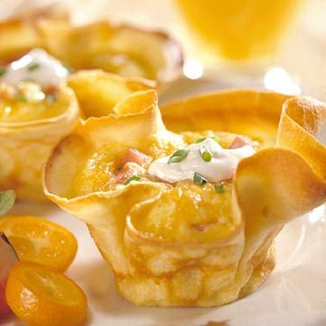 Breakfast Crepe Cups with Eggs, Bacon, Chopped Ham, Cheddar Cheese, and Sour Cream