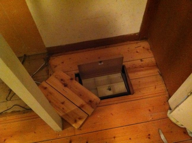 A friend found this hidden safe under in his floor and for Hidden floor safe