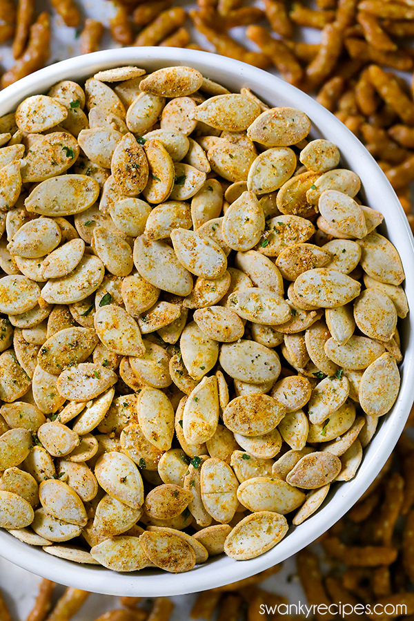 Ranch Pumpkin Seeds - Quick and easy roasted pumpkin seeds with a zesty ranch blend. You'll fall in love with this healthy Ranch Pumpkin Seed recipe. Perfect pumpkin seed snack this autumn. #roastedpumpkinseeds Ranch Pumpkin Seeds - Quick and easy roasted pumpkin seeds with a zesty ranch blend. You'll fall in love with this healthy Ranch Pumpkin Seed recipe. Perfect pumpkin seed snack this autumn. #roastedpumpkinseedsrecipe Ranch Pumpkin Seeds - Quick and easy roasted pumpkin seeds with a zesty #roastedpumpkinseedsrecipe