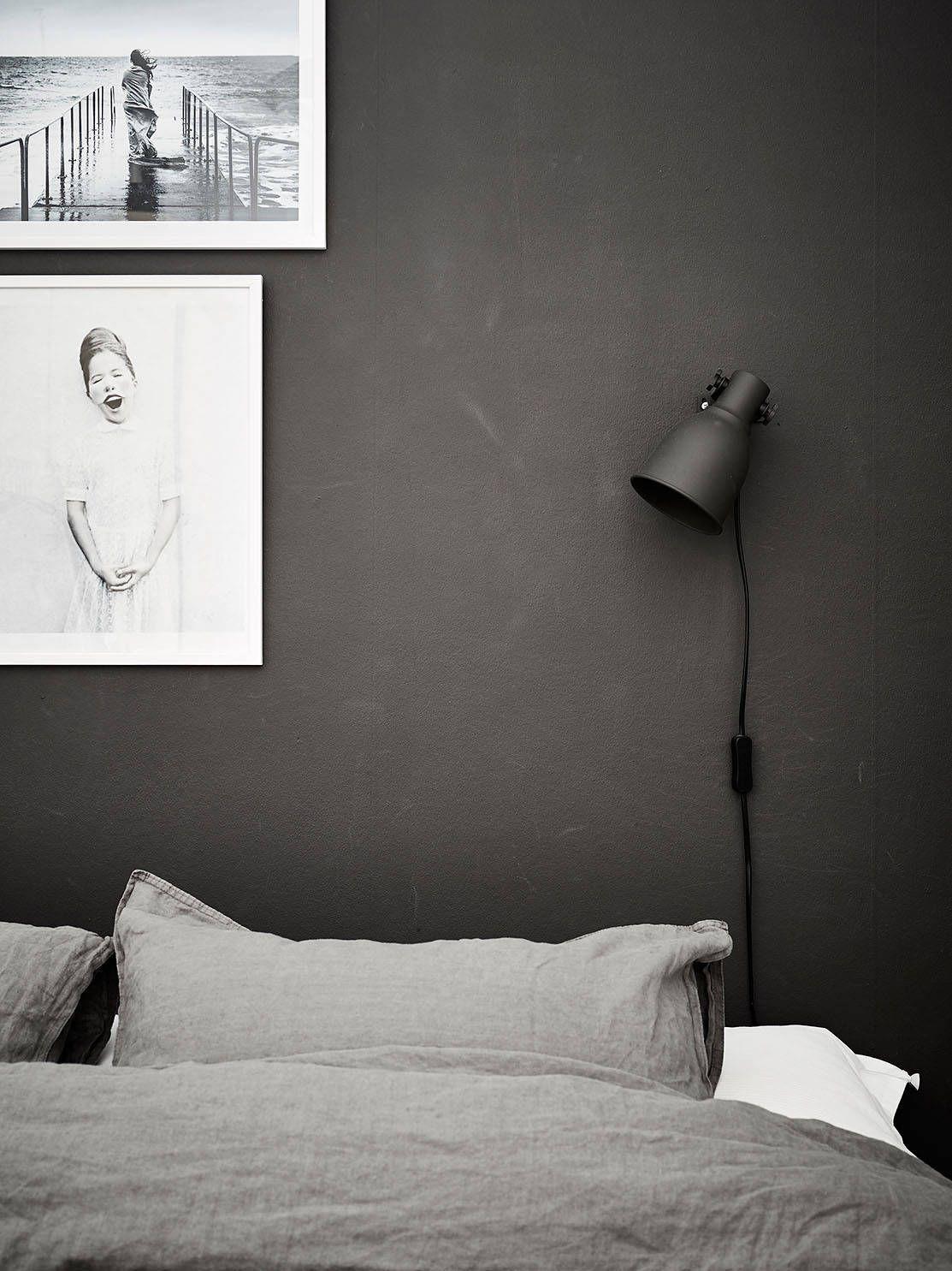 Black bedroom idea with grey linen sheets