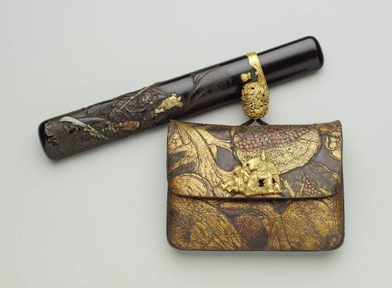 Tobacco-pouch with embossed designs; pipecase with design of the Three Heroes of Shoku (Shu), from the Sangokushi (Sanguozhi); kanamono in the form of Tadamori capturing the oil thief; ojime with ho-o and kiri designs Japanese, Meiji era, mid to late 19th century (before 1889) By Unno Shomin, Japanese, 1844–1915 By Serizawa Ryumin, Japanese, born in 1826, MFA