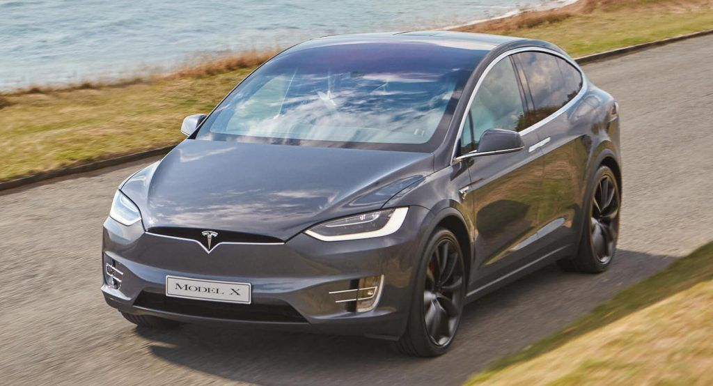 a falling tree hit two tesla model xs coming from opposite directions everyone made it out alive in 2020 tesla model tesla tesla model x pinterest