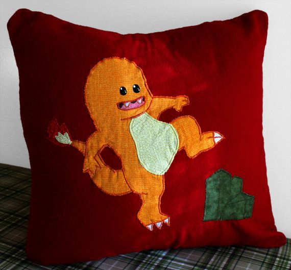 "The Charmander (Charzilla) Throw Pillowcase. Best fits an 18"" x 18"" insert. This Pokemon pillowcase features a patterned appliqué on ""Chilli Pepper"" flannel fabric."