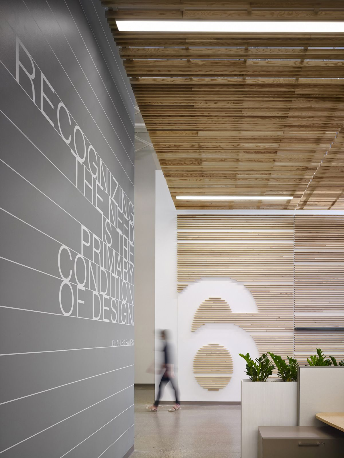 """The large numbers situated along the walls represent the Design Center's """"immersion labs"""" – special areas designed to spark innovation and collaboration among nearly 100 design professionals 