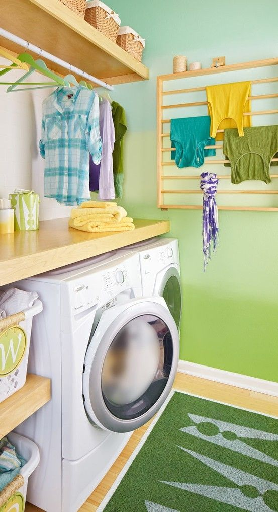 Nice laundry, baskets on one side, counter and room for hanging ...