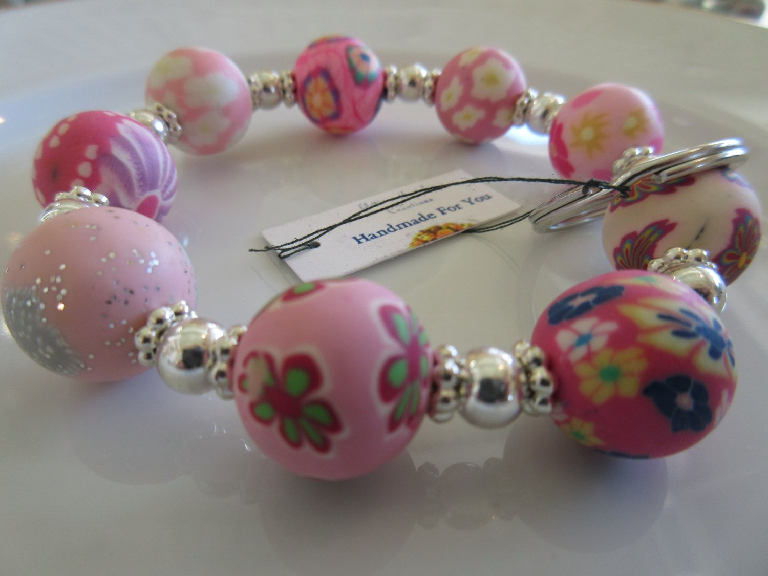 Handmade For You Hands-Free Beaded Bracelet KeyChain Keyring Floral Polymer Clay Beads in Pinks and Silver Stretch Cord Fits Many Sizes K249 by JewelsHandmadeForYou on Etsy
