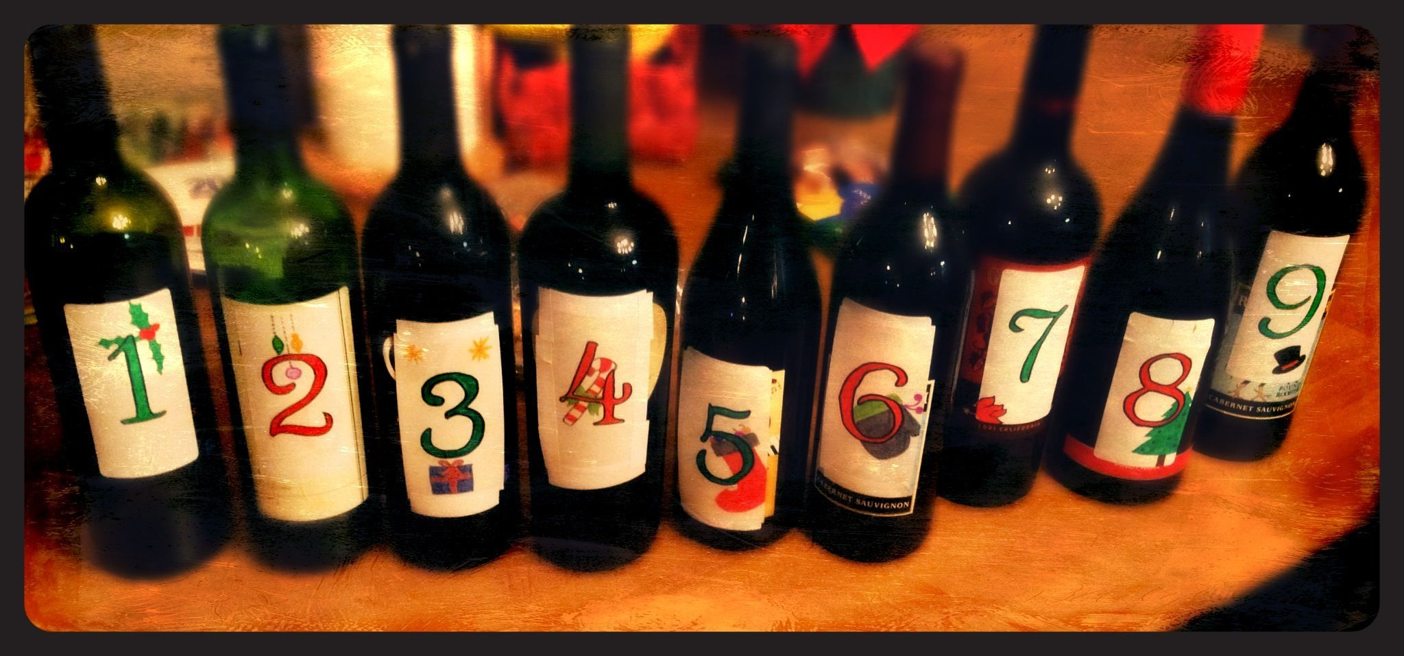 Wine Advent Calendar. So easy and such a fun idea for traditions with friends and family! Make your own labels to make it even more special. Can you make it all the way to December 24th? #wineadventcalendardiy Wine Advent Calendar. So easy and such a fun idea for traditions with friends and family! Make your own labels to make it even more special. Can you make it all the way to December 24th? #wineadventcalendardiy
