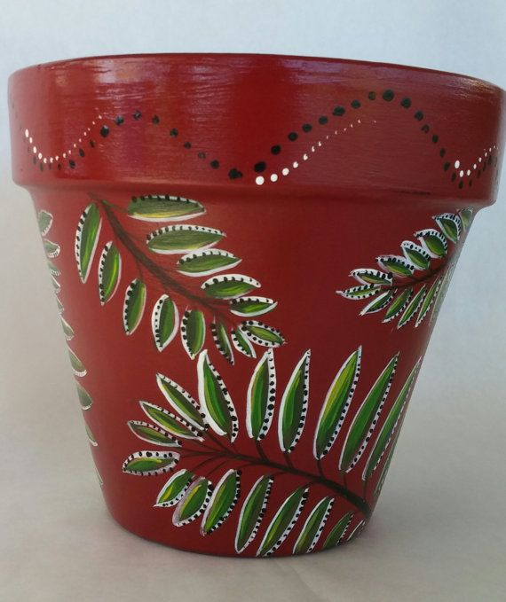 A Tropical Fern Motiff With Rich Green Colors On A Vibrant Dark Red Pot Perfect Outdoors Or In Pot Measu Flower Pot Art Painted Clay Pots Hand Painted Planter