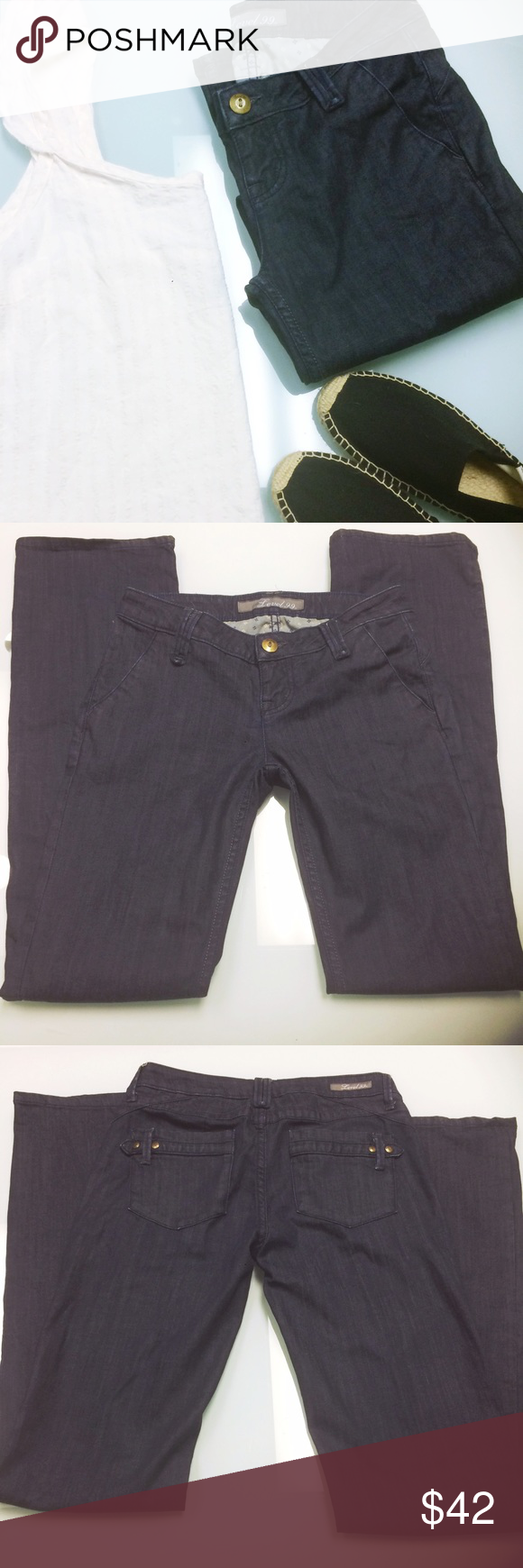 Level 99 Pocket Detail Indigo Jeans Level 99 jeans in a dark Indigo wash with rear pocket details. These are a boot cut style. Size 26. This brand often sells at Nordstrom and Anthropologie. Anthropologie Jeans Boot Cut