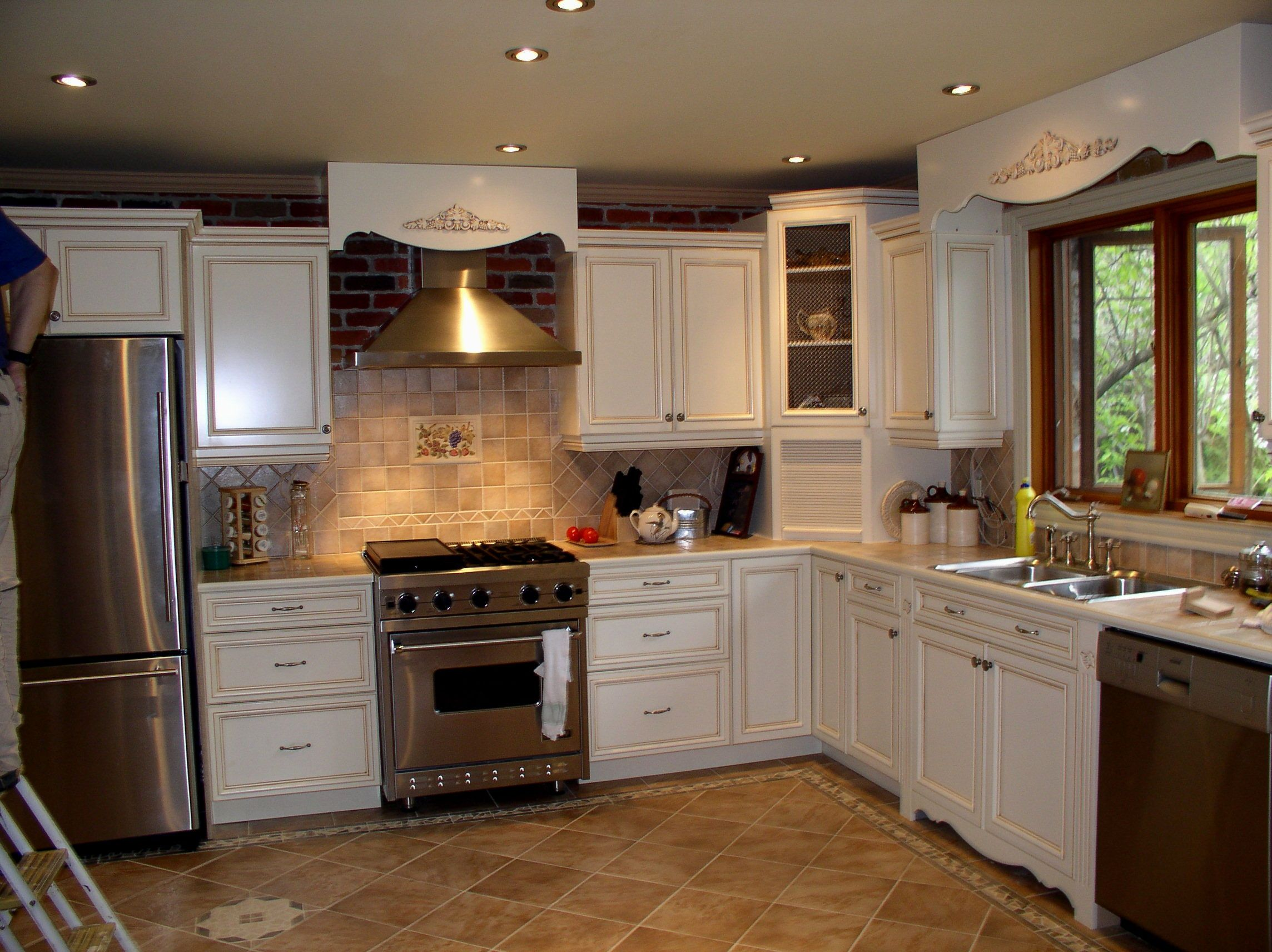 White Kitchen Cabinets Brown Tile Floor