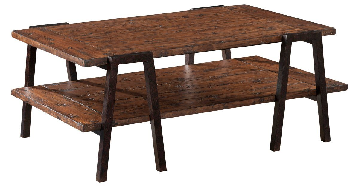 It's difficult to say what we love most about this coffee table: the rustic texture and dark finish of the planked pine, or the unexpected angles of the sturdy iron legs.