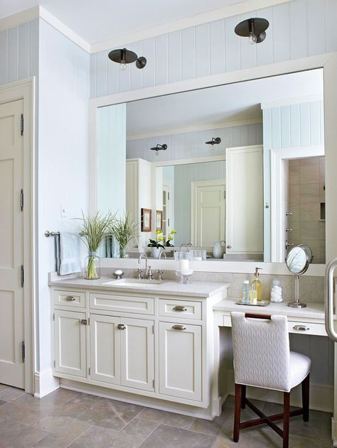 Antique Sconces Hang Above The Oversize Mirror And Add Unexpected Flair To Light Bright Bathroom Dark Finish On Fixtures Adds Weight