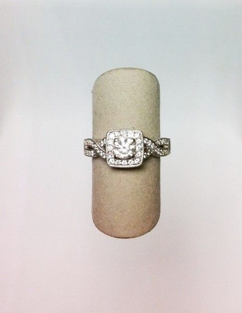 14kw engraved engagement ring with .41ct round center diamond, square-shaped diamond halo, and diamonds along crossover partial split-shank (.50ctw). #diamondengagementring DVVS Fine Jewelry