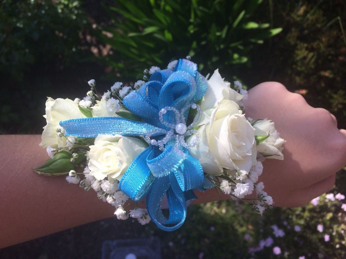 Prom wrist corsage with white roses, baby\'s breath blue ribbon ...