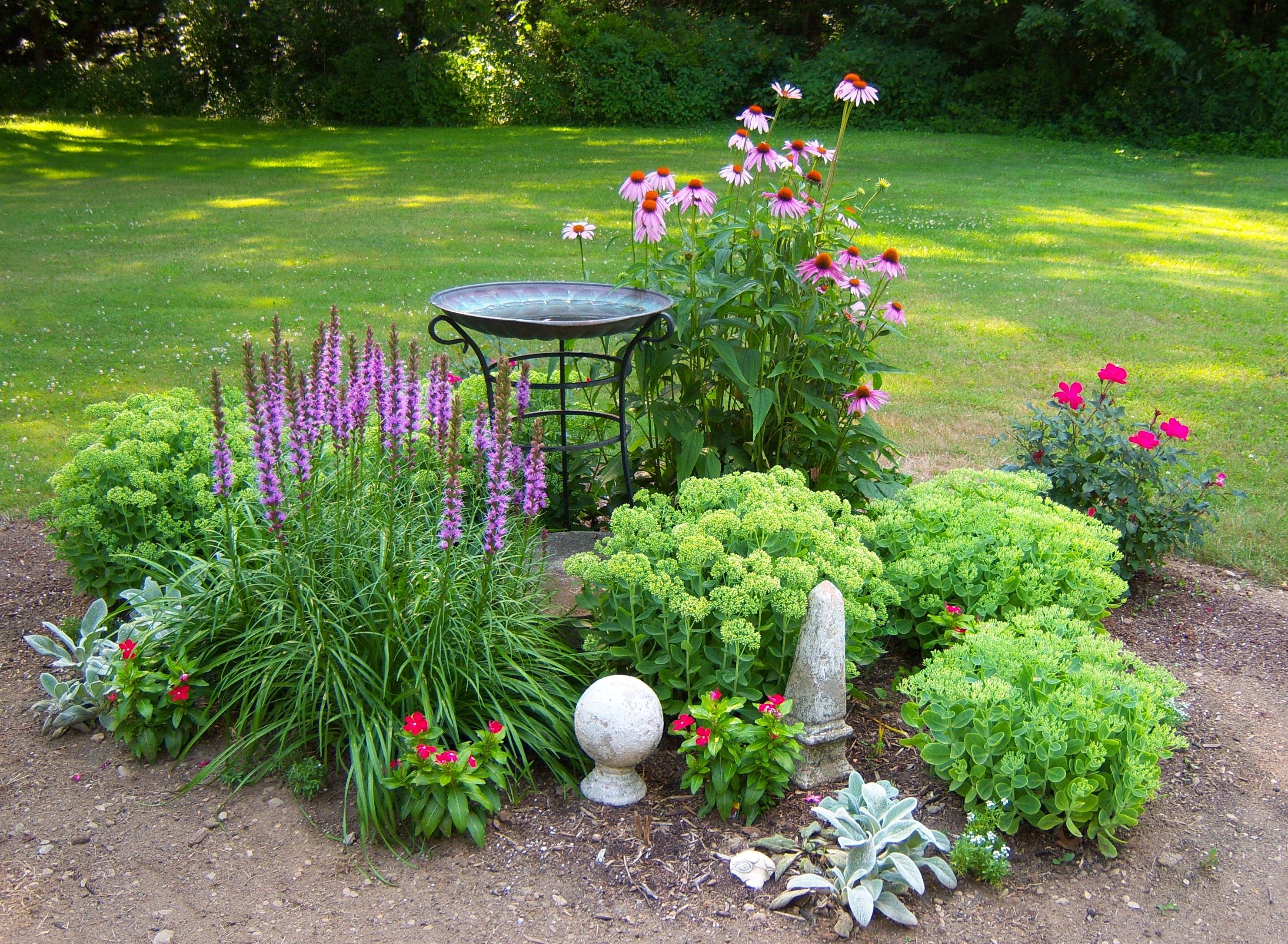 Garden designs with bridges and wishing wells landscaping ideas - How I Disguised My Ugly Septic Tank Cover It S Under The Bird Bath Backyard Landscapinglandscaping Ideasbackyard