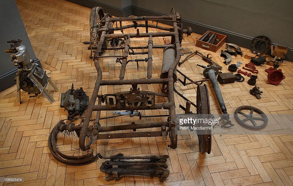 The chasis and other parts of a 1900 De Dion Bouton antique car ...