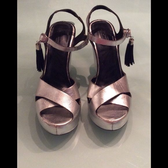 Matiko Silver Leather Peeptoe Wedge (Lynn) Sandal Comfortable wedge sandal preowned bit still in great condition. Silver leather is super soft. Difficult to photograph light reflects off silver color. There are no scuff on back heel, again light cast shadows. Cute tassel hangs off ankle strap. Sandals sold @ Anthropology Matiko Shoes Wedges