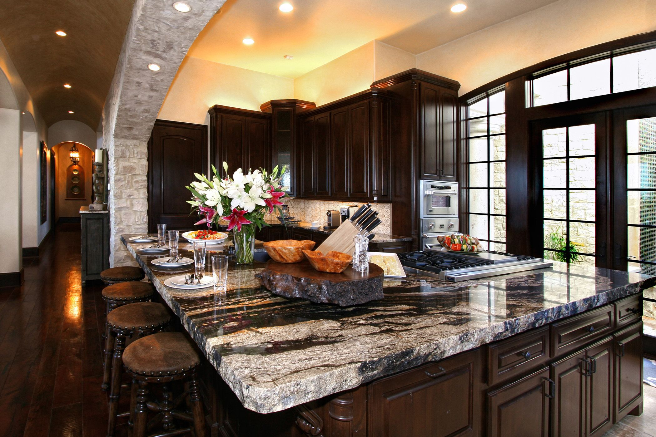 Beau Black And Grey Granite Countertop Connected By Black Wooden Kitchen Cabinet  And Some Small Patching Lamps