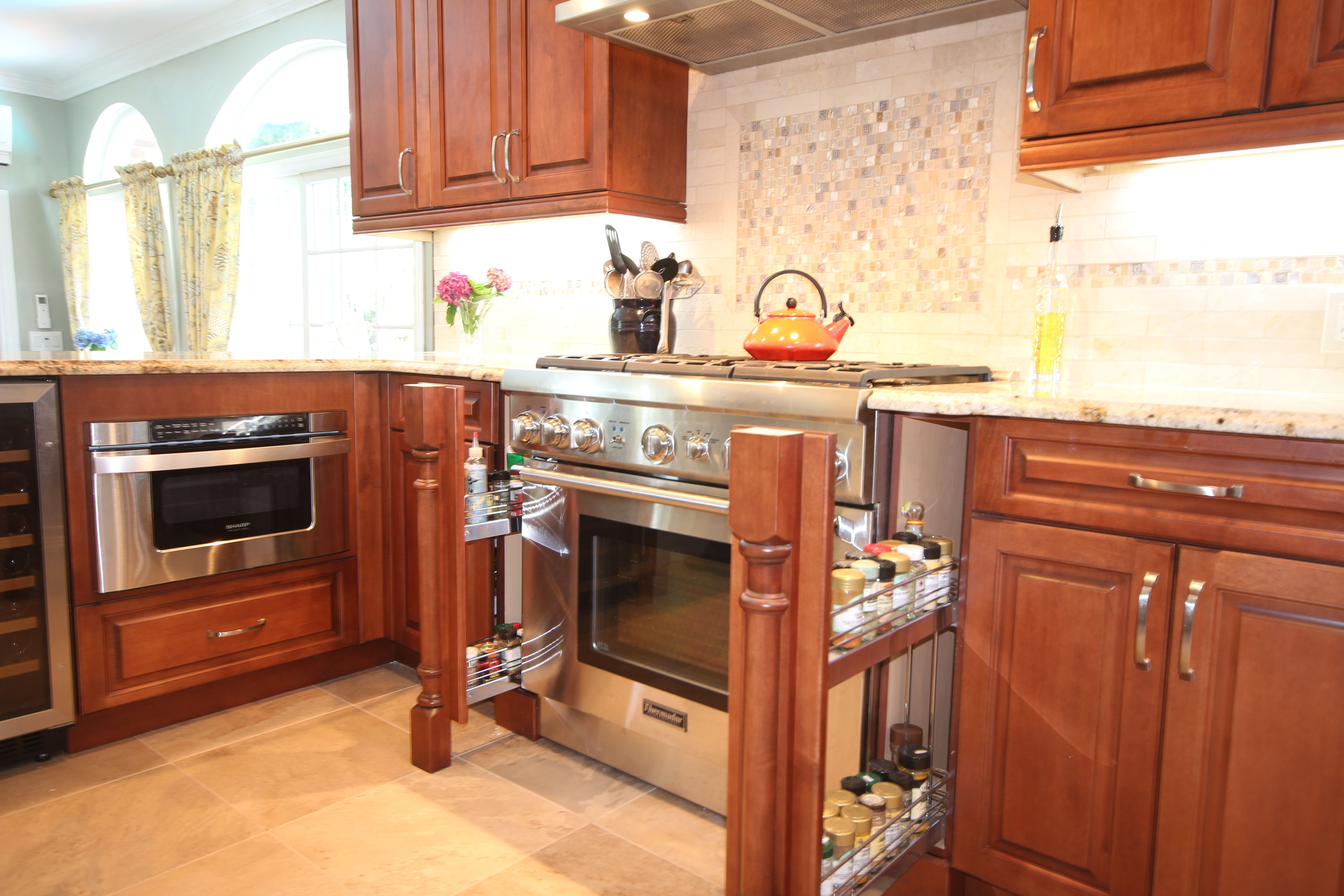 The perfect solution to the awkward space that is sometimes left over when having to fit cabinetry and appliances together. The disappearing spice racks are functional , out of the way , and big enough so you can find almost anything you might need to flavor your cooking