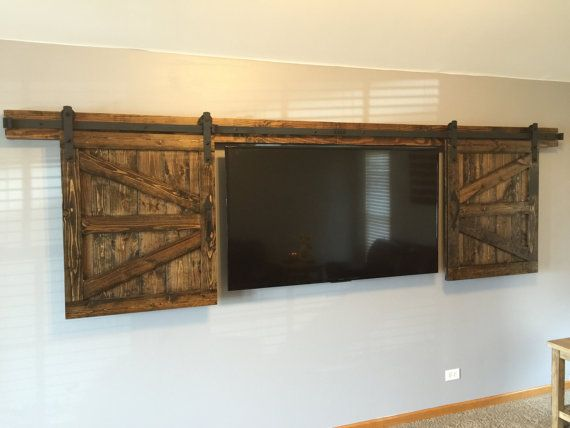 Hidden sliding tv barn door set rustic tv barn door by for Hidden sliding screen door