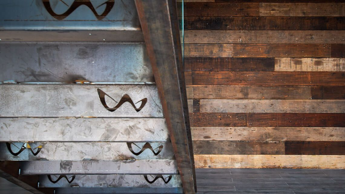 A wall covered in reclaimed wood can add texture and