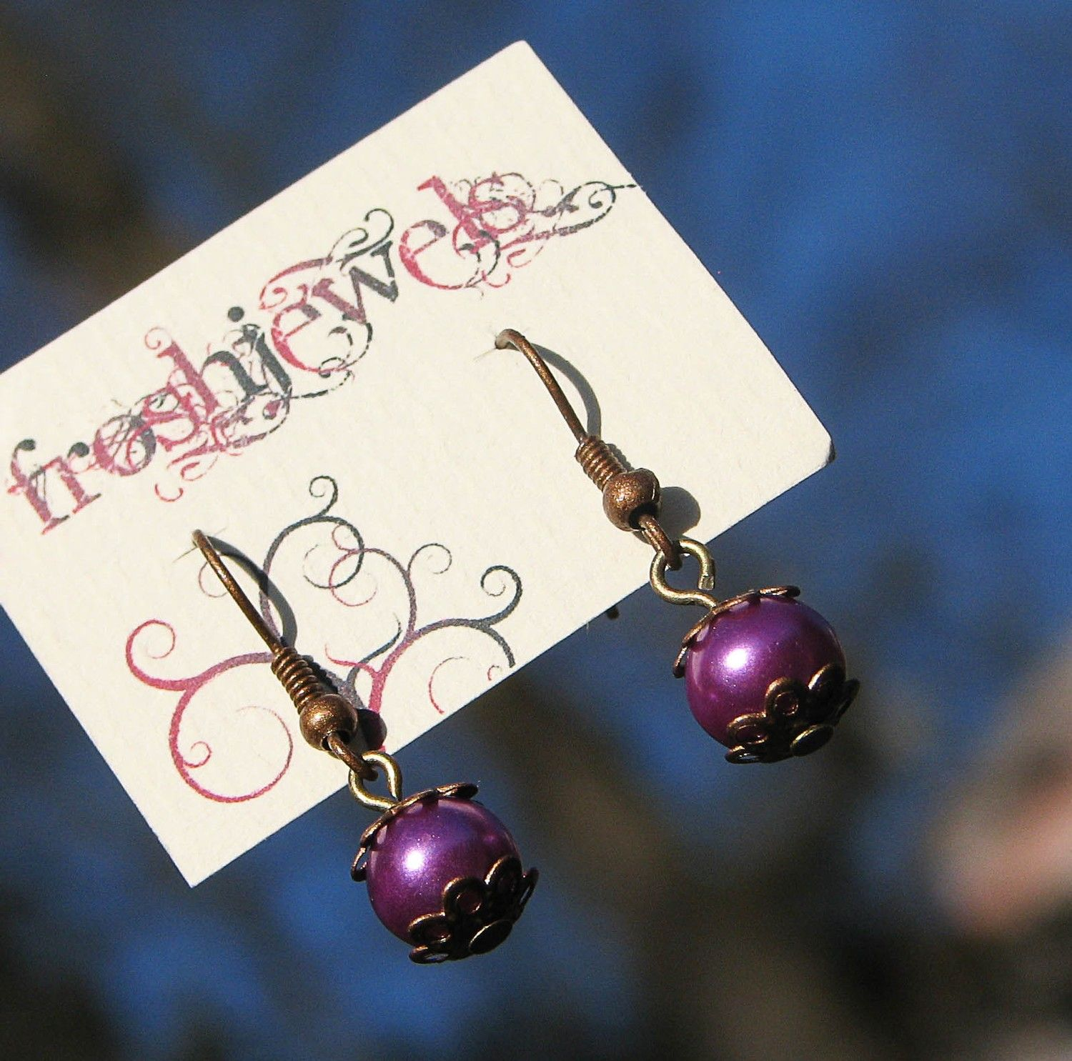 Little Purple Ones ... Froshjewes original earrings. $0.20, via Etsy.