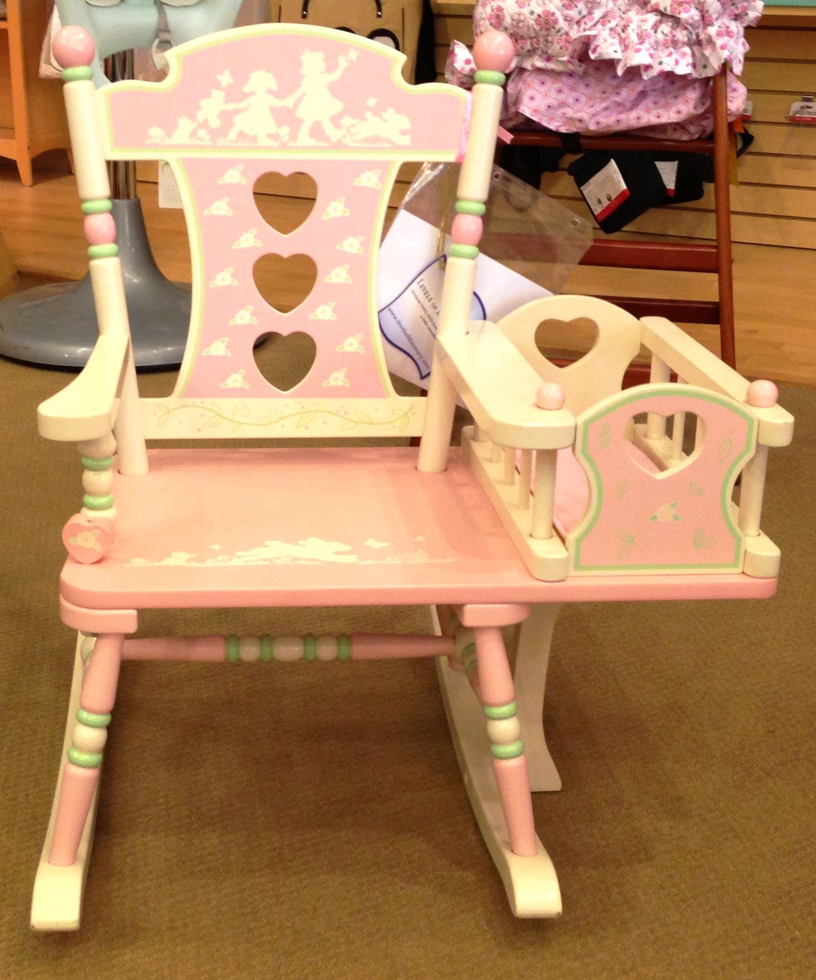 This pink chair with a small crib attached is one of