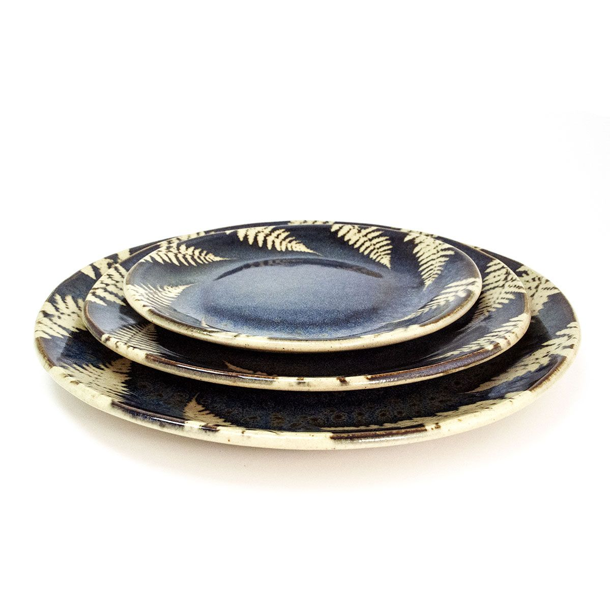 One-of-a-kind plates using an impressed fern pattern.