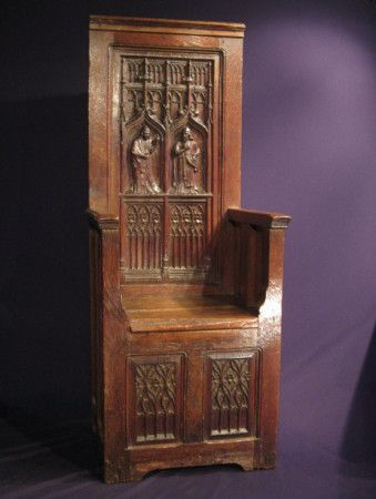 The High Back Carved With Gothic Tracery And Centred By Two Carved Bishop  Figures, Within Gothic Arches. Below Is A Boxed Seat With Two Smaller Gothic  ...