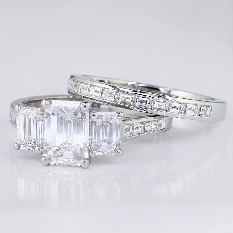 We recently finished this stunning 3 stone emerald cut for Emerald and diamond wedding ring