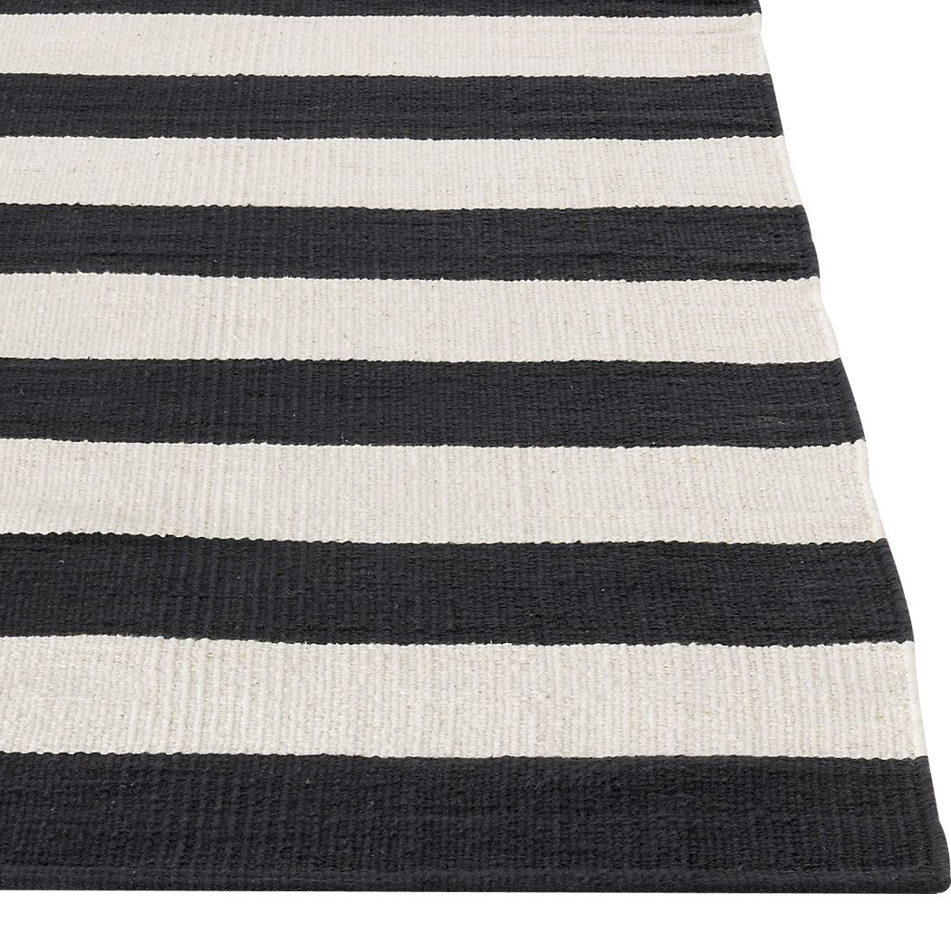Shop Olin Black Striped Cotton Dhurrie 5 X8 Rug Broad Bands Of Black And Ivory Stretch Horizontally Across This Crate And Barrel Rugs Black Rug Dhurrie Rugs