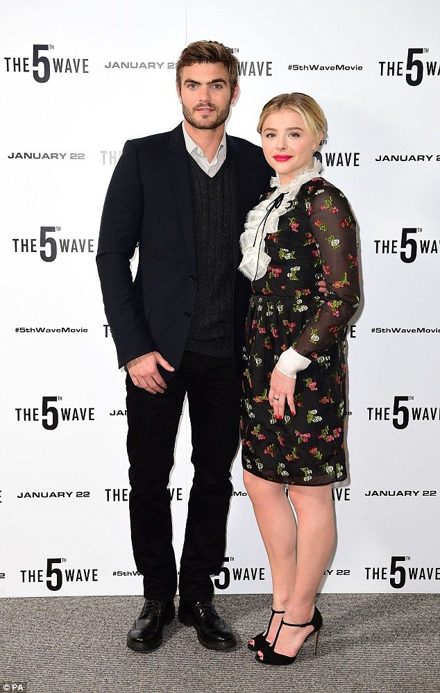 Gorgeous pair: Chloe posed with her handsome co-star from The 5th WaveAlex Roe...