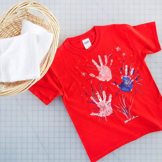 Your little firecracker can craft his or her own Firecracker T-Shirt with some handprints and a little paint.