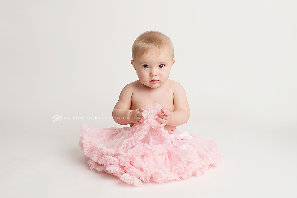 Cute baby girl in pink tutu photo baby photography cornwall devon cute baby photos cute baby photo ideas 6 months old baby photo session