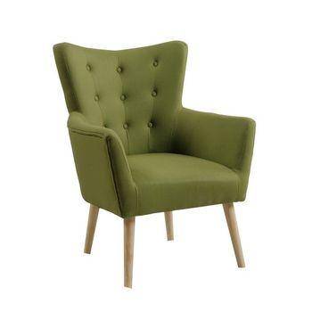 Ce fauteuil vert amande en feutrine capitonné apportera la douceur