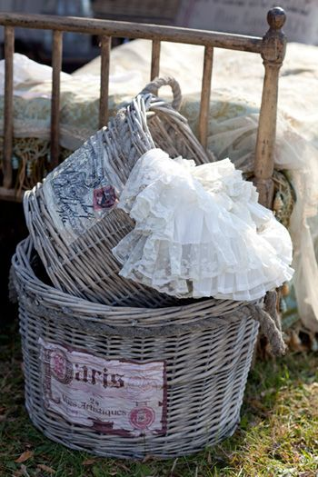<3  Love this aged baskets with vintage print... great decorating/storage idea!