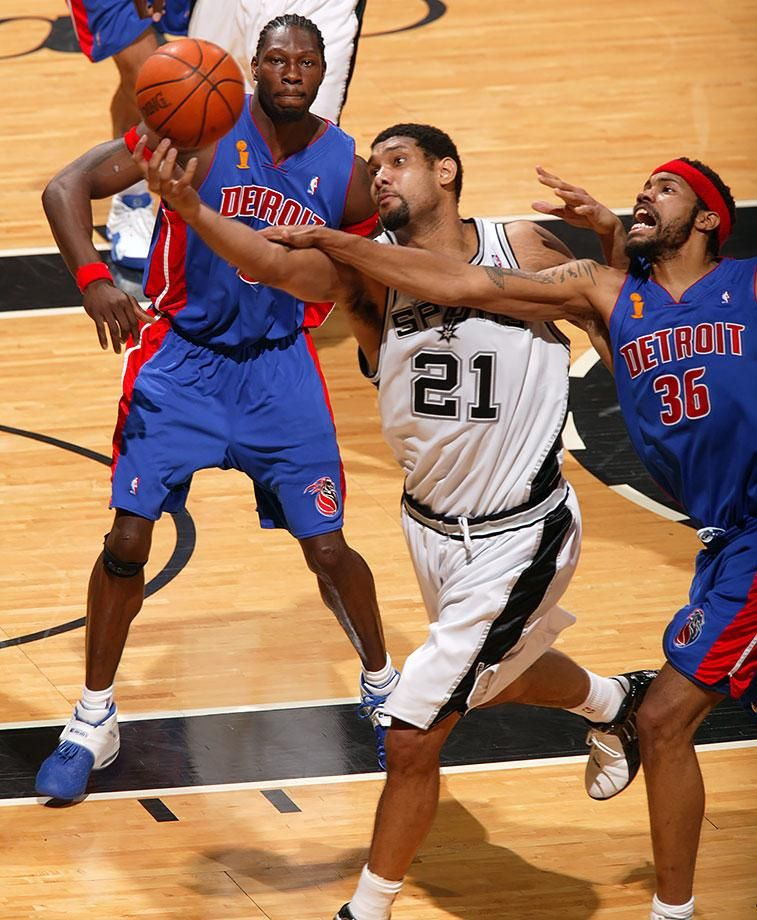 Tim Duncan drives to basket against Rasheed Wallace in Game 7 between the Spurs and Pistons. Duncan scored a game-high 25 points and 11 rebounds as he led San Antonio to their third title and won his third Finals MVP award.
