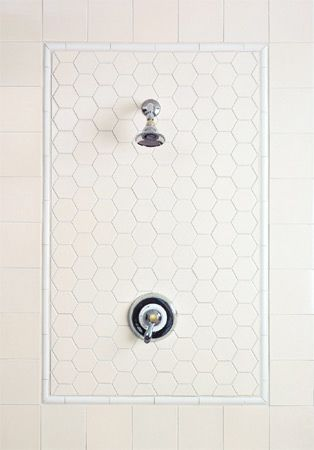 simple white tile shower feature - I like the three styles of tile, one color