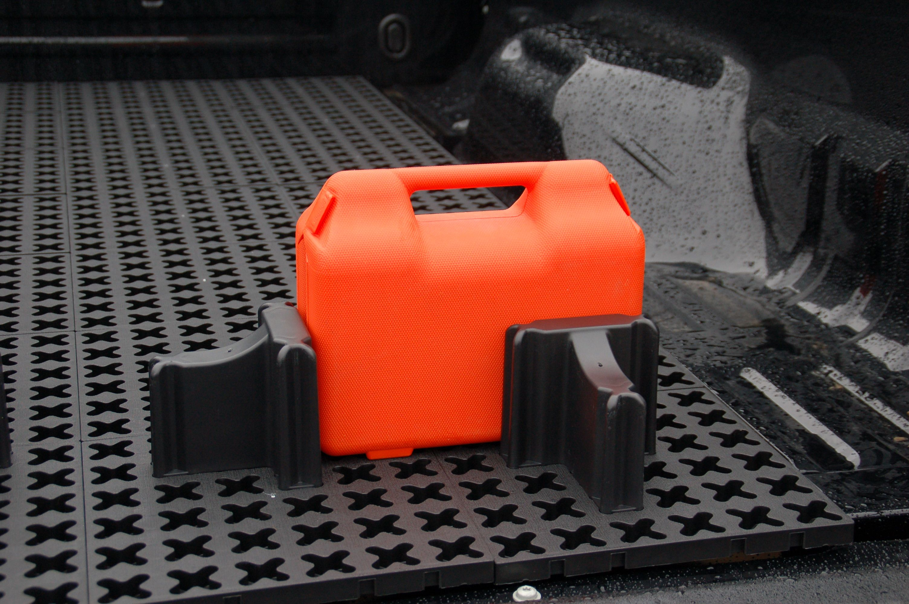 Camping gear stays put in truck bed with the Tmat Cargo