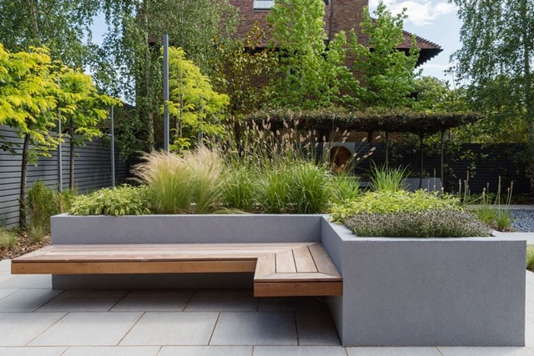 Raised borders and seating borrowed space modern garden ...