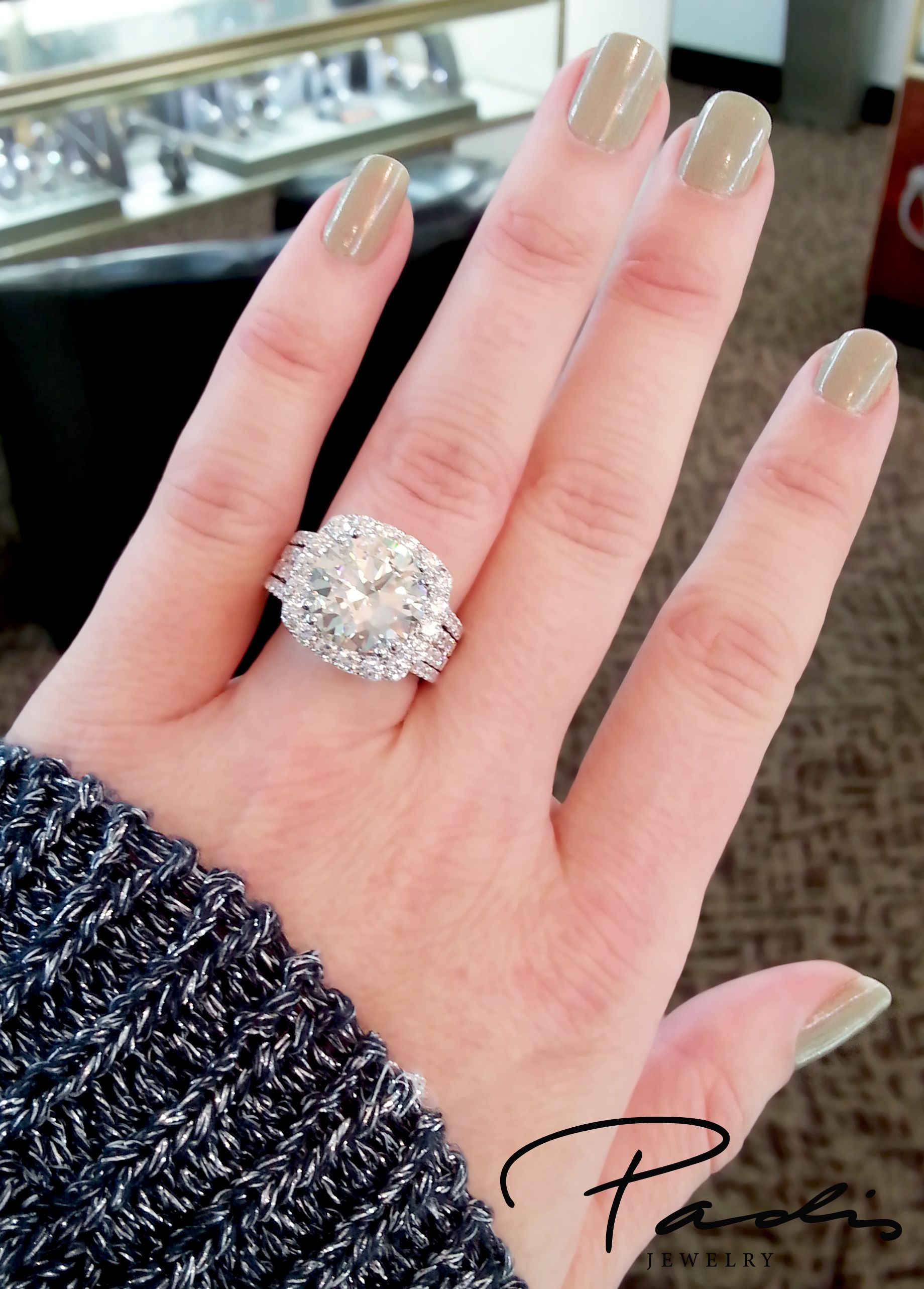 Cushion halo engagement ring with a 5.52ct round diamond center ...