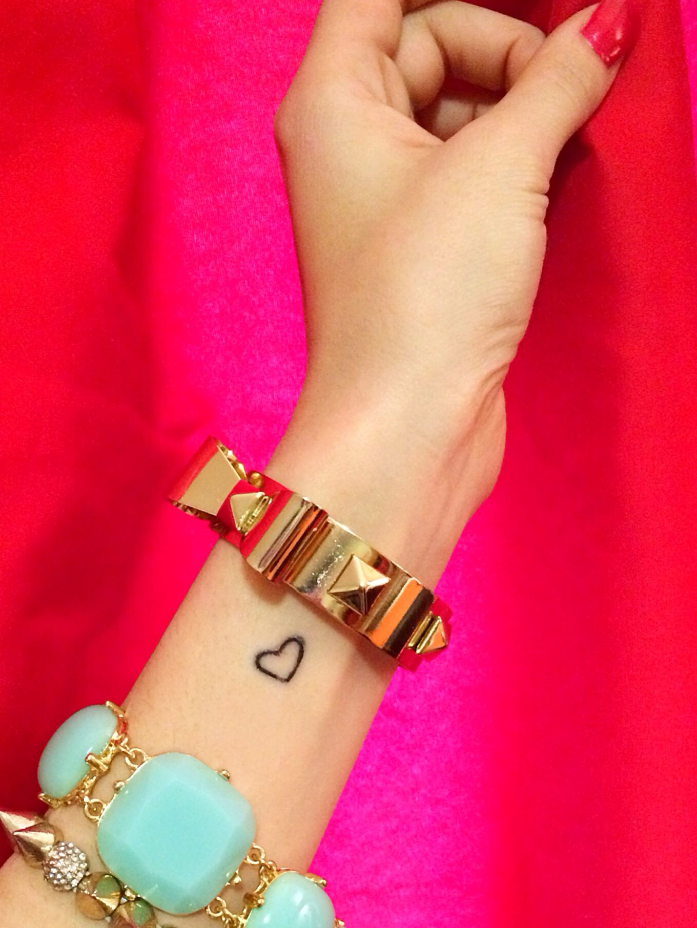 First tattoo idea, but on other hand Small heart wrist